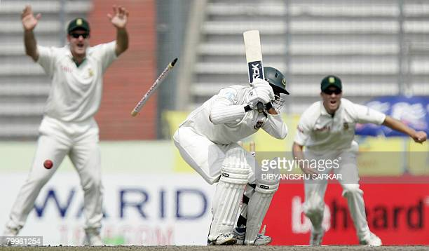 South African cricketers Graeme Smith and AB Devilliers celebrate the dismissal of Bangladeshi batsman Mohammad Rafique during the third day of the...