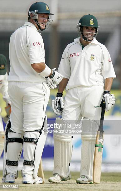 South African cricketers Graeme Smith and Neil McKenzie congratulate each other after setting a new world record for the maximum runs scored by...
