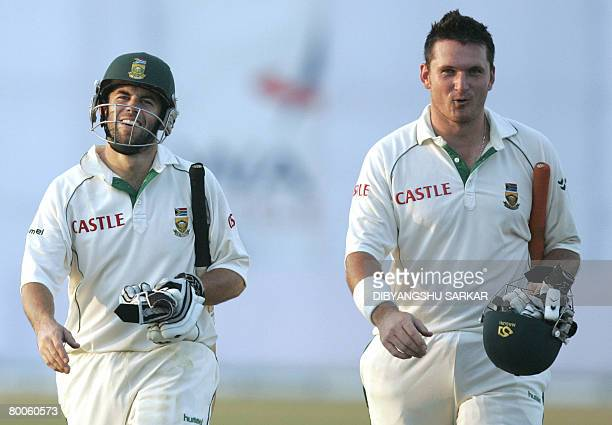 South African cricketers Graeme Smith and Neil McKenzie walk off the field at the end of play on the first day of the second Test match between...