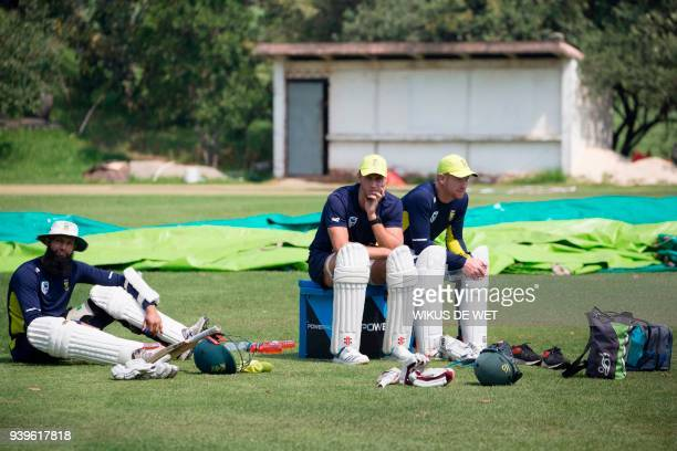 South African cricketers Hashim Amla Theunis de Bruyn and Heinrich Klaasen take a break during a team practice session on March 29 2018 in...