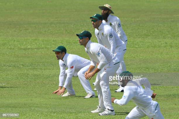 South African cricketers Hashim AmlaFaf du Plessis Aiden Markram and Dean Elgar take the field in the slip cordon during the first day's play in the...