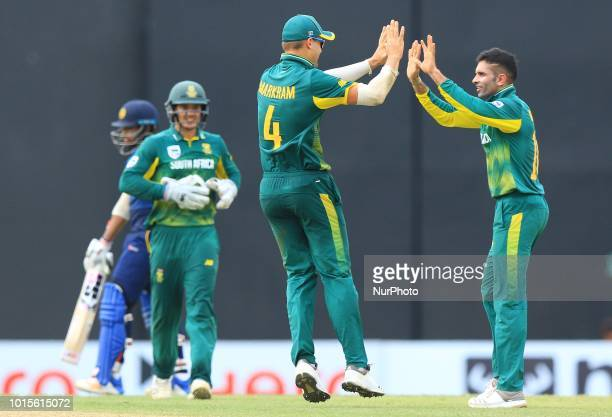 South African cricketers Keshav Maharaj and Aiden Markram celebrate during the 5th and final One Day International cricket match between Sri Lanka...
