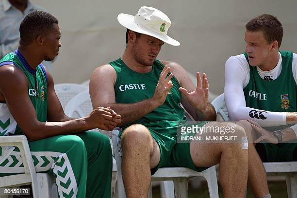South African cricketers Makhaya Ntini and Morne Morkel listen to captain Graeme Smith during a training session ahead of the second Test match...