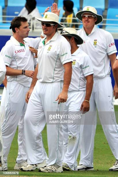 South African cricketers Paul Harris Dale Steyn and team captain Graeme Smith celebrate after the dismissal of Pakistani batsmen Mohammad Hafeez on...