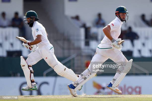 South African cricketers Theunis de Bruyn and Hashim Amla run between the wickets during the 3rd day's play in the 2nd test cricket match between Sri...