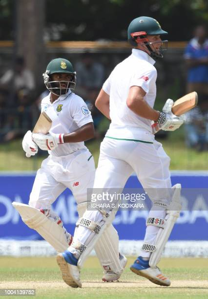 South African cricketers Theunis de Bruyn and Temba Bavuma run between the wickets during the fourth day of their second Test match between Sri Lanka...