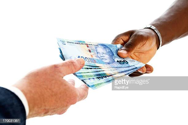 south african currency featuring nelson mandela being passed to man - south african currency stock pictures, royalty-free photos & images
