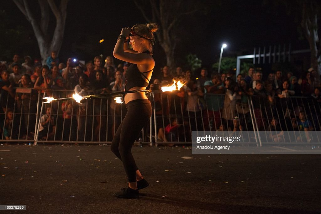 A South African dancer in costumes performs during 2015 Cape Town Carnival at the Green Point Fan Walk in Cape Town on March 14, 2015. The theme for Cape Town Carnival 2015 is elemental. It celebrates fire, water, air and earth.