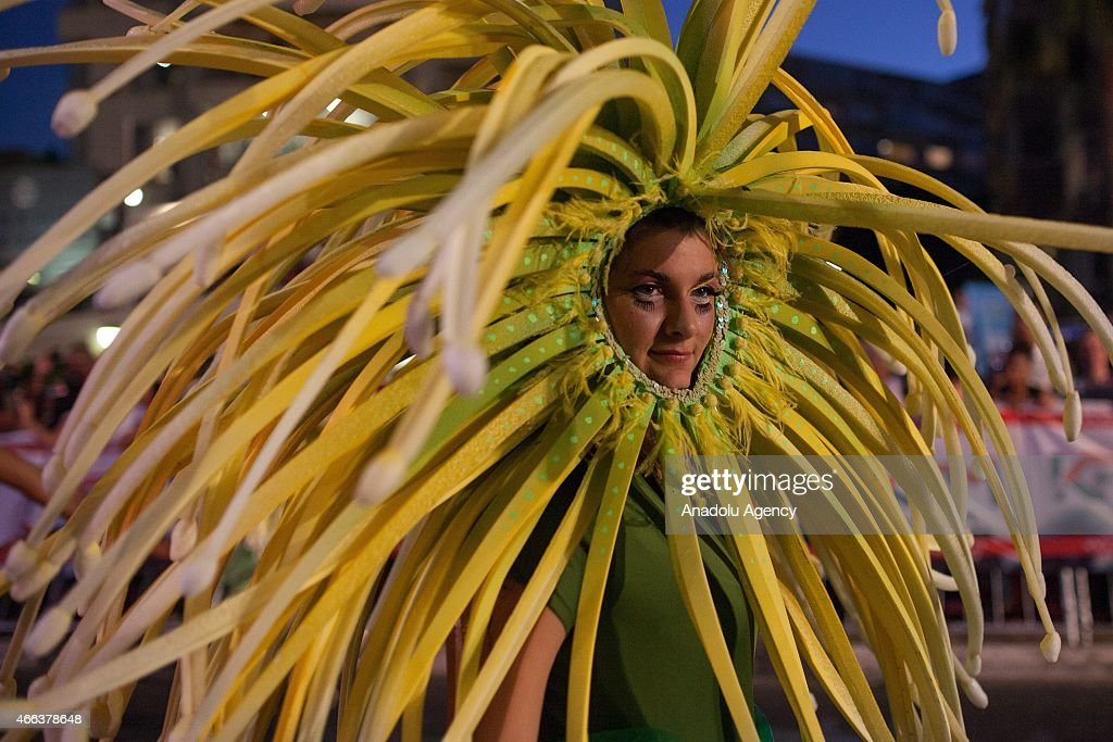 A South African dancer is seen in costumes during 2015 Cape Town Carnival at the Green Point Fan Walk in Cape Town on March 14, 2015. The theme for Cape Town Carnival 2015 is elemental. It celebrates fire, water, air and earth.