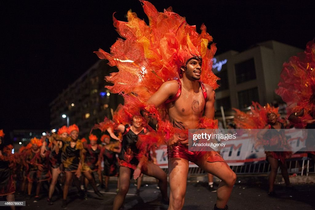 South African dancers in costumes perform during 2015 Cape Town Carnival at the Green Point Fan Walk in Cape Town on March 14, 2015. The theme for Cape Town Carnival 2015 is elemental. It celebrates fire, water, air and earth.