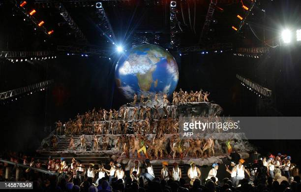 South African dancers perform in front of a giant globe during the welcoming ceremony and cultural event organized by the South African government at...