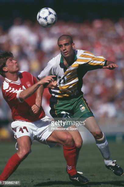 South African defender Pierre Issa and Danish player Brian Laudrup clash as they battle for the ball in the 1998 FIFA World Cup Group C match between...