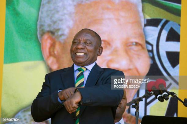 South African Deputy President and newlyelected president of the ruling African National Congress Cyril Ramaphosa gestures during a rally on February...