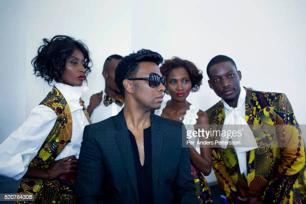 South African designer David Tlale with models backstage before showing his latest collection at Mercedes Benz Africa fashion week Africa on November...