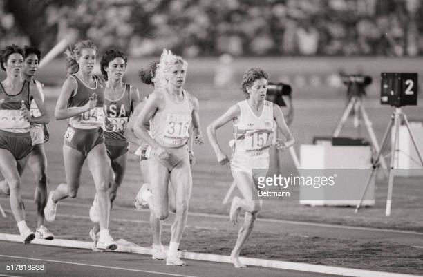 South African distance runner Zola Budd, team Great Britain, leading the 3000 meters race at the 1984 Olympics, followed by eventual gold medal...