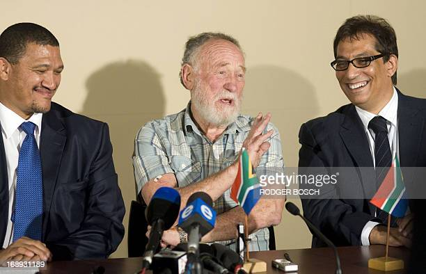 South African doctor Cyril Karabus flanked by South African Deputy Minister of Foreign Affairs Marius Fransman and Doctor Iqbal Surve gives a press...