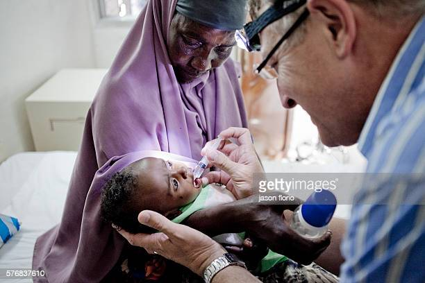 A South African doctor helping a dehydrated child at Villa Somalia Clinic in Mogadishu March 2011