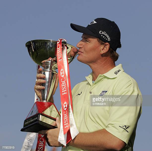 South African Ernie Els celebrates with the trophy after winning the final, six and four, against Argentinian Angel Cabrera, in the World Match Play...