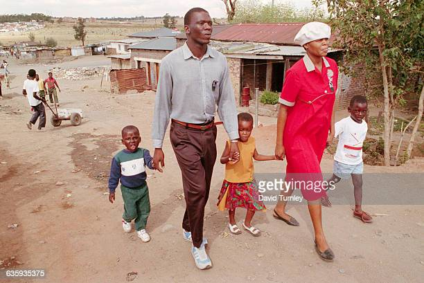 South African Family Walk in Their Township