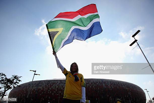 South African fan arrives at the Soccer City stadium in Johannesburg on June 11 2010 in Johannesburg South Africa The FIFA 2010 World Cup kicks off...