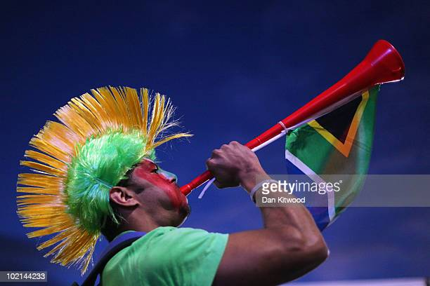 A South African fan blows a vuvuzela at a fan viewing area on June 16 2010 in Cape Town South Africa South Africa take on Uruguay tonight at the...