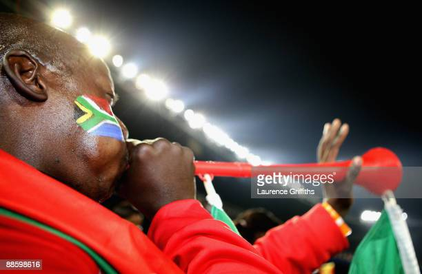 South African fan blows a vuvuzela during the FIFA Confederations Cup match between Spain and South Africa at Free State Stadium on June 20, 2009 in...