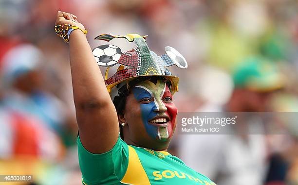 South African fan celebrates a boundary during the 2015 ICC Cricket World Cup match between South Africa and Ireland at Manuka Oval on March 3 2015...