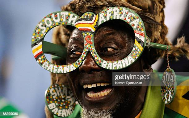 South African fan cheers during the FIFA Confederations Cup match between Spain and South Africa at the Free State stadium on June 19 2009 in...
