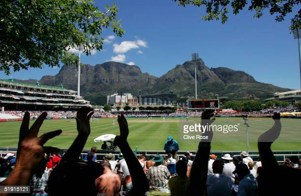 South African fans celebrate as the wicket of Marcus Trescothick falls at the start of Englands second innings during the fourth day of the third...