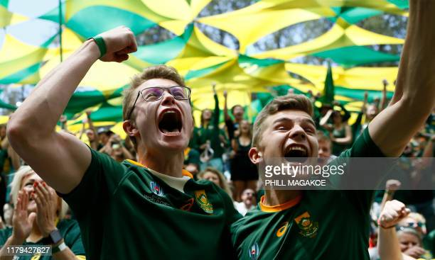 South African fans react as their team scores a try while watching the ugby World Cup 2019 Final between South Africa and England at International...