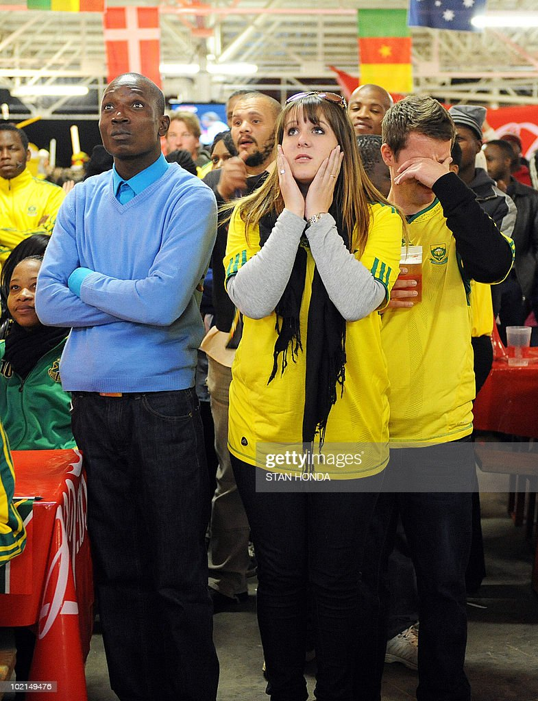 South African fans react toSouth Africa's goalkeeper Itumeleng Khune receiving a red card as they watch the South Africa vs Uruguay game at the Silverstar Casino in Muldersdrift on June 16, 2010 during the 2010 World Cup football tournament. AFP PHOTO/Stan Honda