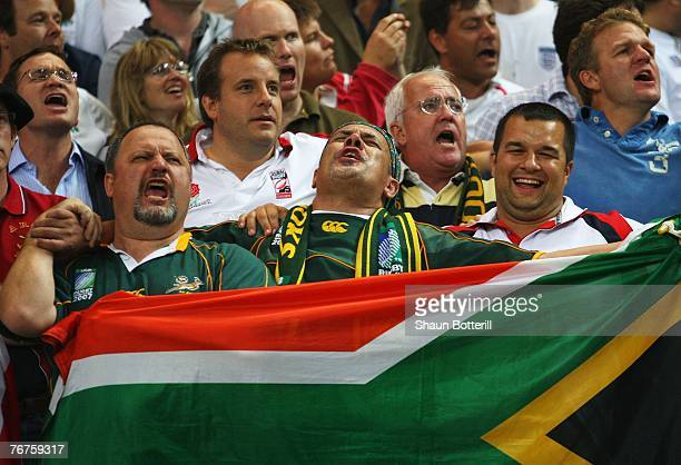 South African fans sing the national anthem prior to kickoff during the Rugby World Cup Pool A match between England and South Africa at the Stade de...