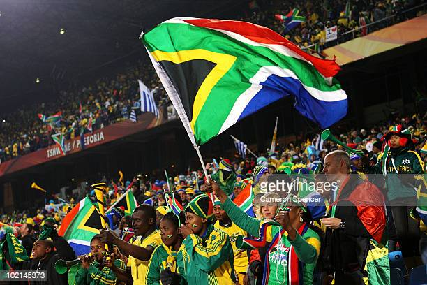 South African fans wave a flag as they enjoy the atmosphere ahead of the 2010 FIFA World Cup South Africa Group A match between South Africa and...