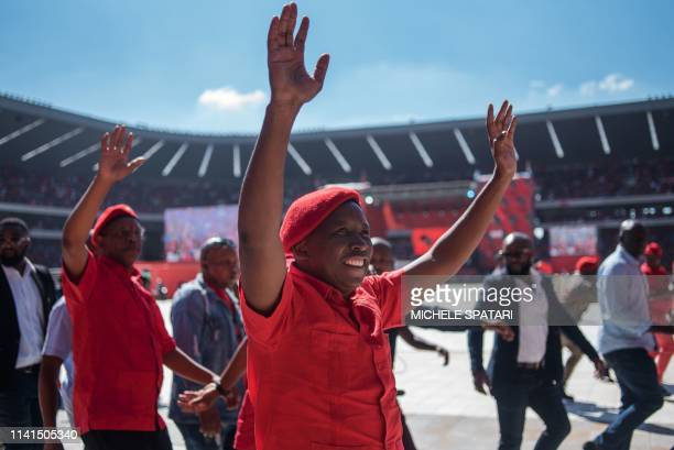 South African far-left and opposition party Economic Freedom Fighters leader Julius Malema acknowledges the crowd during the final EFF presidential...