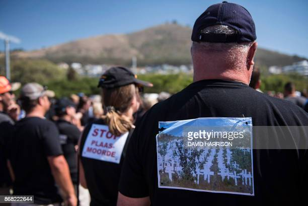 South African farmers farm workers attend a demonstration at the Green Point stadium to protest against farmer murders in the country on October 30...