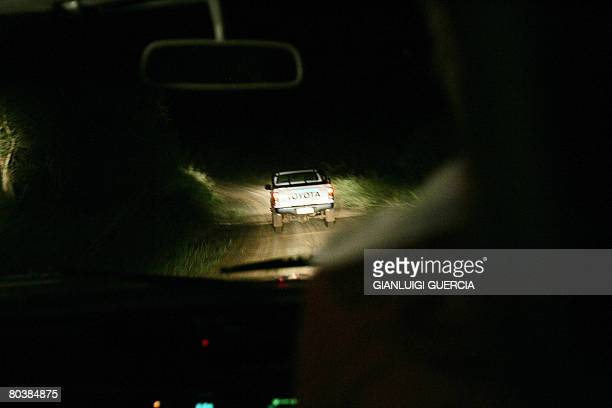 South African farmers patrol on March 17 2008 the farming area of Waterpoort in South Africa in search of Zimbabwean illegal immigrants stealing and...