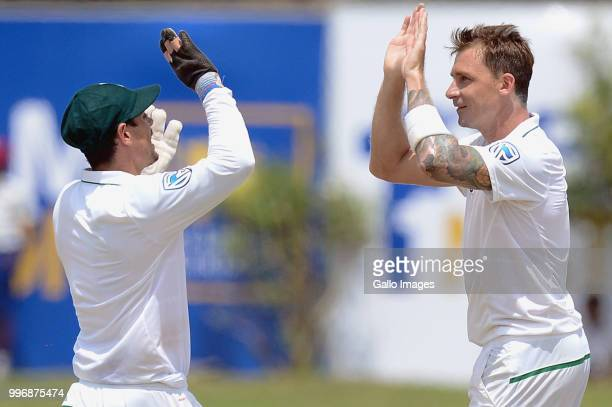 South African fast bowler Dale Syten giving high fives to wicketkeeper Quinton de kock after dismissing Kusal Mendis during day 1 of the 1st Test...