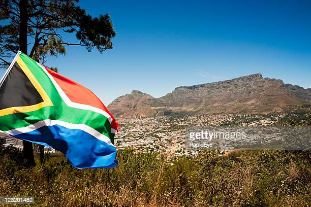 south african flag against table mountain, cape town - south stock pictures, royalty-free photos & images