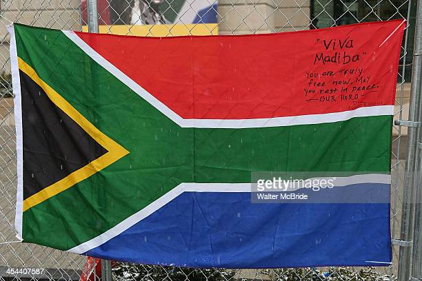 South African flag with a tribute to Nelson Mandela written on it hangs outside the South African Embassy on December 8 2013 in Washington DC Mandela...