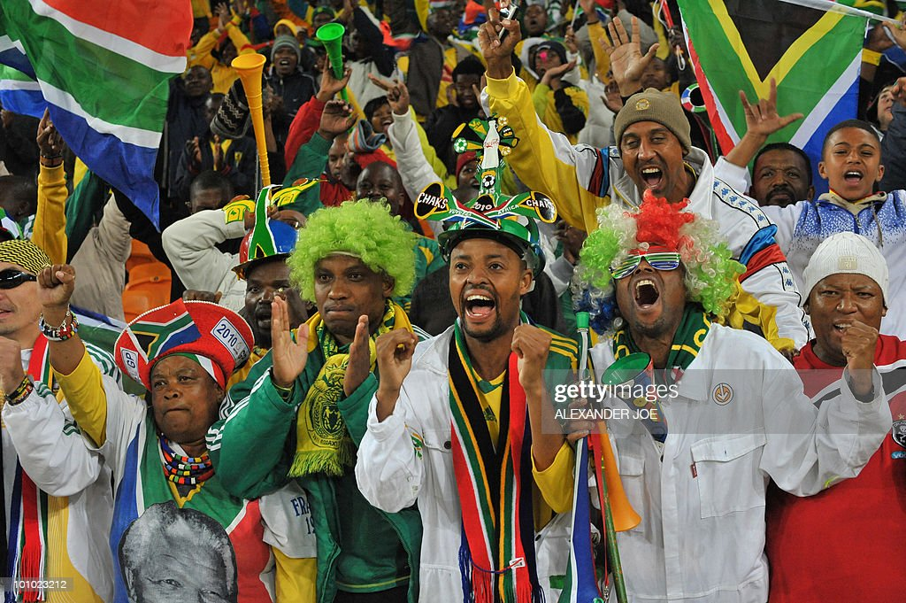 South African football fans sing the national Anthem during the friendly match between South Africa vs Colombia at Soccer City Stadium in Soweto on May 27 , 2010 ahead of the FIFA 2010 World Cup in South Africa.