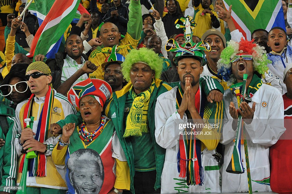 South African football fans their national anthem during the friendly football match between South Africa and Colombia at Soccer City Stadium in Soweto, Johannesburg on May 27, 2010. The 2010 FIFA World Cup football championship is due to take place in South Africa from June 11 to July 11.