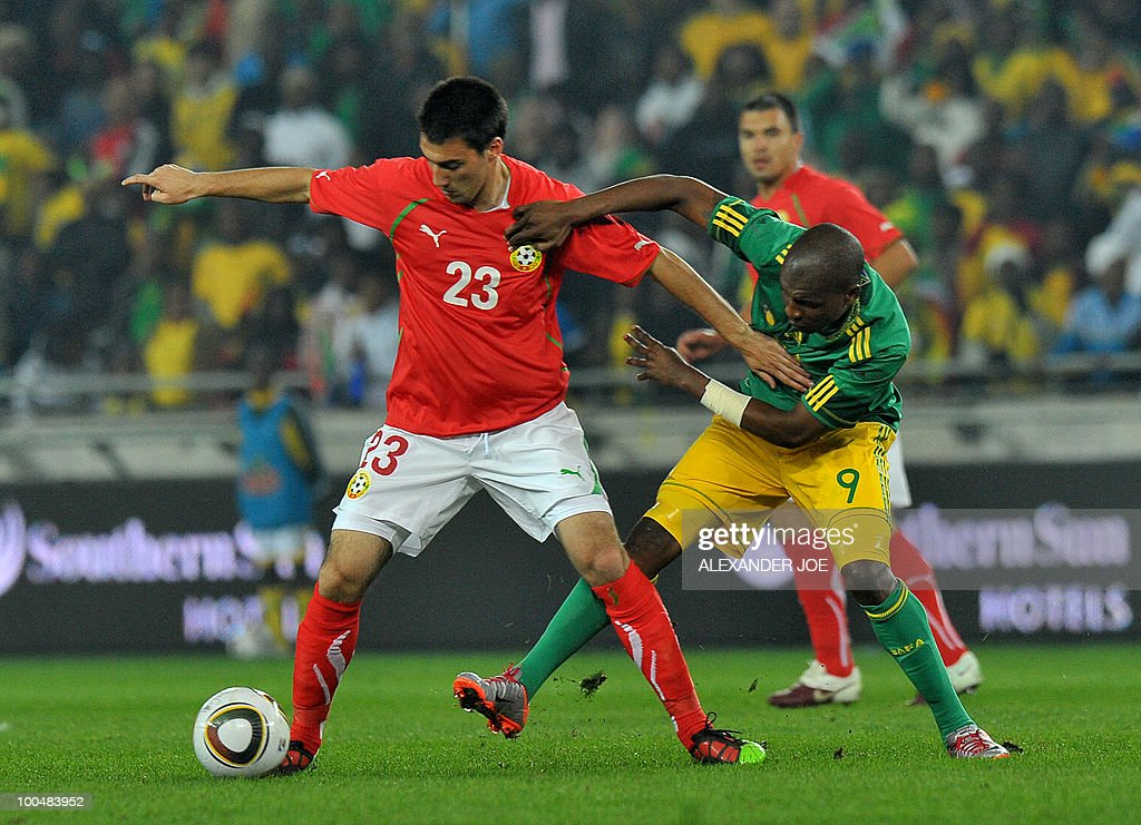 South African footballer Katlego Mphela holds back Ivelin Popov of Bulgaria during the friendly football match between South Africa vs Bulgaria at Orlando Stadium in Soweto on May 24, 2010 ahaed of the FIFA 2010 World Cup in South Africa.