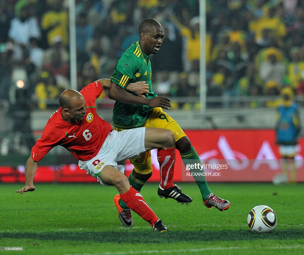 South African footballer Katlego Mphela (9) is tackled by 6 Stanislav Angelov Midfielder of Bulgaria during the friendly football match between South Africa vs Bulgaria at Orlando Stadium in Soweto on May 24, 2010 ahaed of the FIFA 2010 World Cup in South Africa.