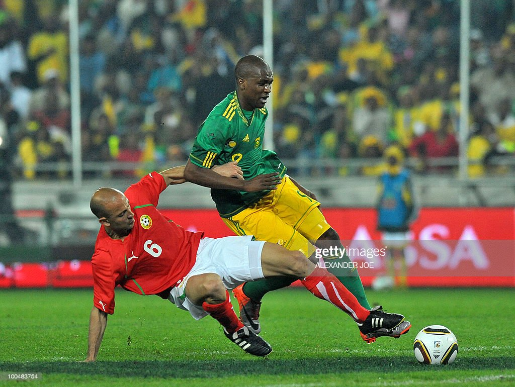 South African footballer Katlego Mphela (9) is tackled by Stanislav Angelov (6), midfielder of Bulgaria's team during the friendly football match between South Africa vs Bulgaria at Orlando Stadium in Soweto on May 24, 2010 ahaed of the FIFA 2010 World Cup in South Africa.