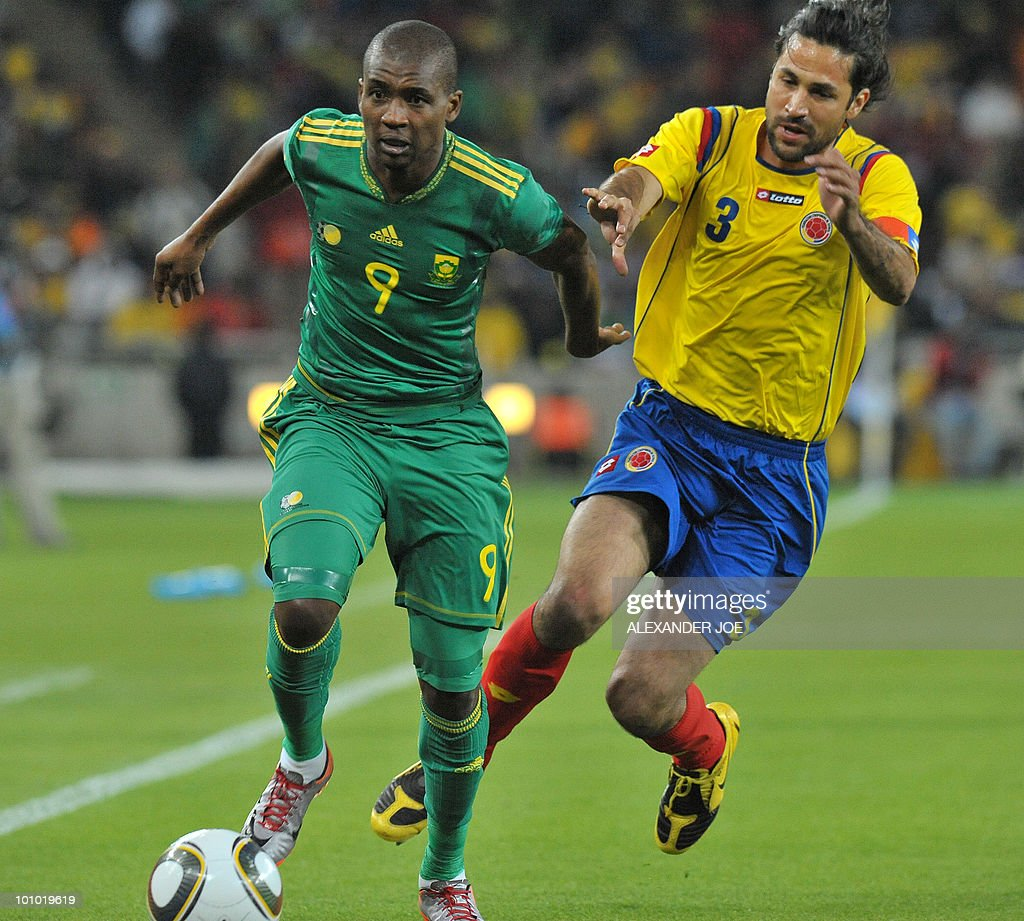 South African footballer Katlego Mphela vies with Colombia's Mario Yepes during a friendly football match between South Africa vs Colombia at Soccer City Stadium in Soweto on May 27 , 2010 ahaed of the FIFA 2010 World Cup in South Africa.