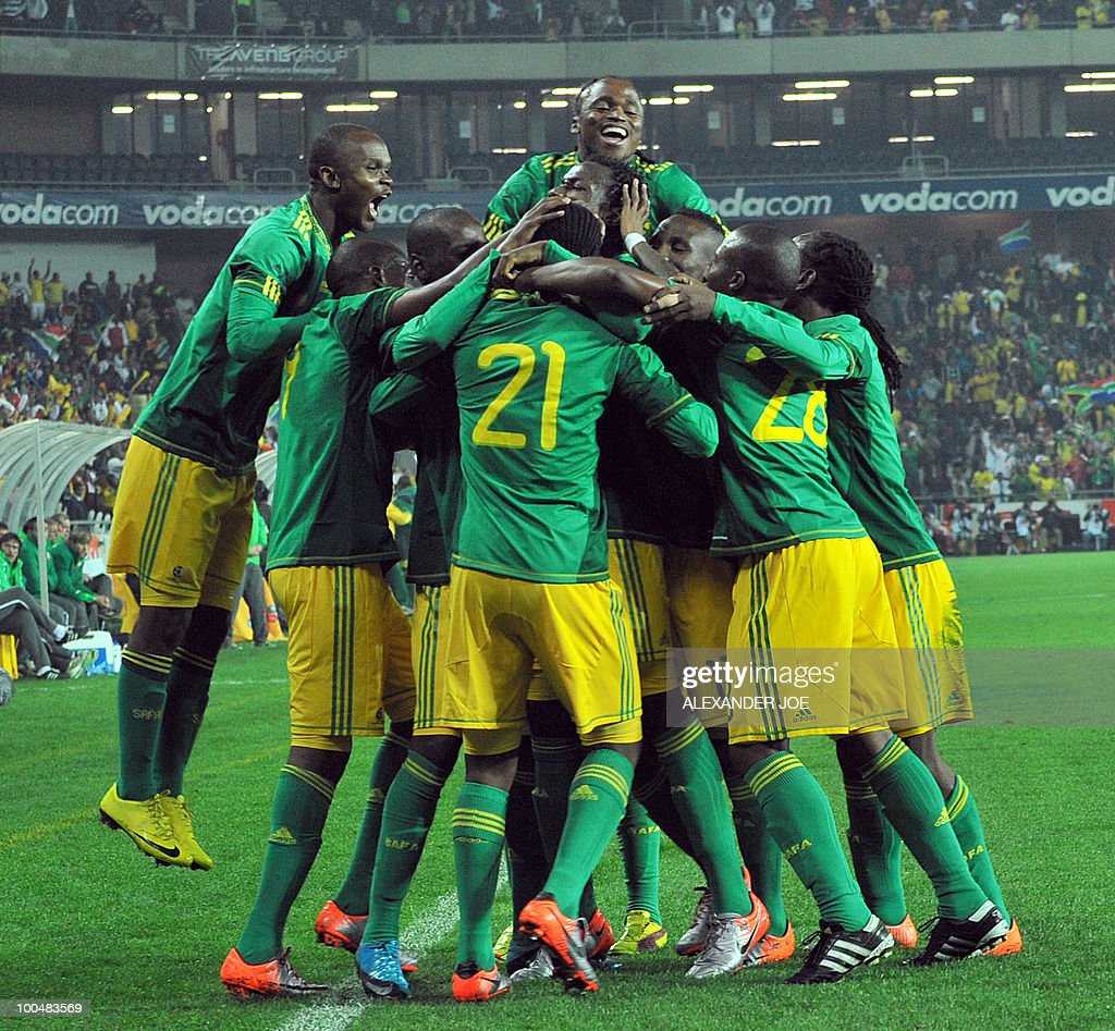 South African footballer Siyabonga Sangweni (#21) celebrates with team mates scoring the first goal against Bulgaria during the friendly football match between South Africa vs Bulgaria at Orlando Stadium in Soweto on May 24, 2010 ahaed of the FIFA 2010 World Cup in South Africa.