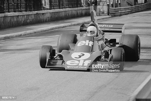 South African Formula One racing driver Jody Scheckter drives the Elf Team Tyrrell 007 Ford Cosworth DFV V8 in practice prior to finishing in 7th...