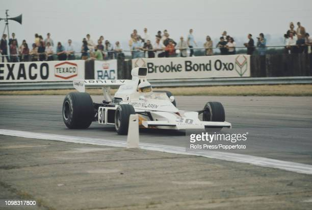 South African Formula One racing driver Jody Scheckter drives the Yardley Team McLaren McLaren M23 Cosworth V8 in practice prior to competing in the...
