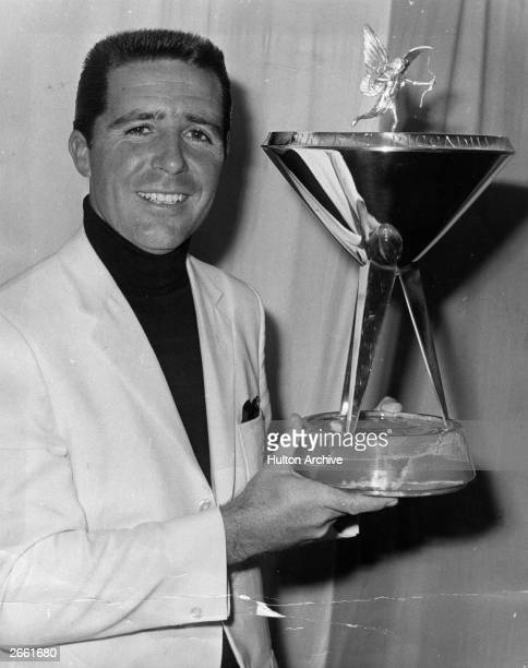 South African Gary Player having beaten New Zealander Bob Charles in the finals of the Piccadilly Match Play Championship at Wentworth Surrey...