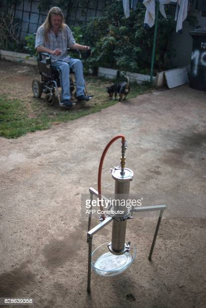 South African Gerd Bader affected by Multiple Sclerosis and who manufactures concentrated cannabis oil is seen near the apparatus with which he...